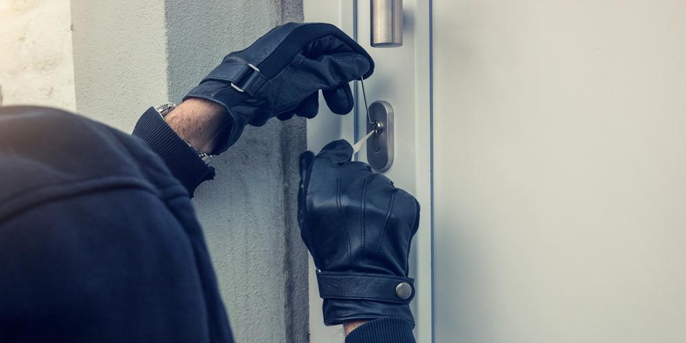 criminal picking lock